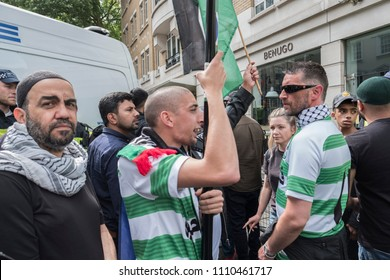 Muslims attending the Al Quds Day rally shout abuse to provoke the opposition protesters in London, 10/06/18.