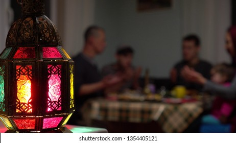 Muslims break their fast at the time of the call to prayer for the evening prayer. Sitting at a dining table