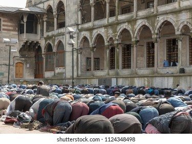 Muslims praying together for friday prayer in Blue Mosque, Sultanahmet, Istanbul.