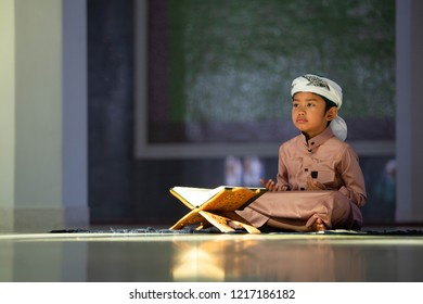 Muslims read the Quran reading sacred books of Muslims around the world. In the mosque lay on a wooden board.low light