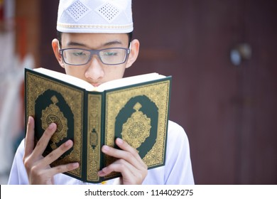 Muslims Read The Quran - Sacred Books Of Muslims Around The World