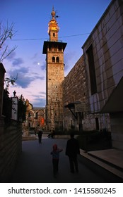 Muslims and tourists go to The Umayyad Mosque, also known as the Great Mosque of Damascus. Syria before the war. Damascus, Syria, Middle East. November 22, 2007.