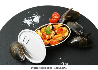 mussels cooked and served in a tin can.