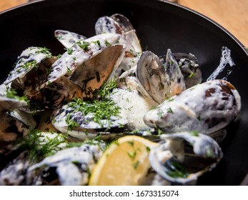 Mussels with garlic white sauce in a bowl. Restaurant