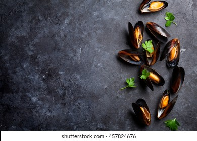 Mussels on stone table. Top view with copy space