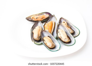 mussels on a white plate close-up