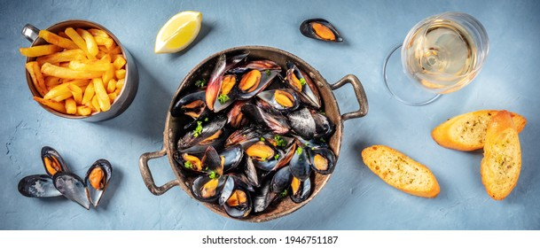 Mussels panorama with wine, fries, and toasts