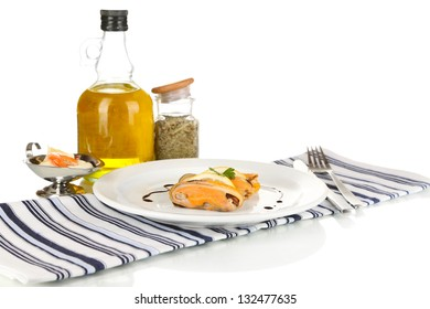 Mussels with sauce on plate isolated on white