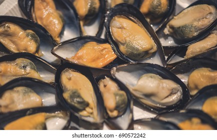 Mussels in shells on a plate. Asian food and seafood