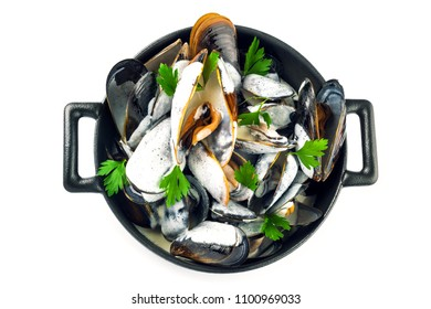 Mussels in a white wine and cream sauce. Classic French meal Moules marinière isolated on white. Top view shot.