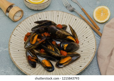 Mussels in wine with lemon. Seafood. Clams in the shells. Delicacy for gourmands.