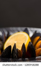 Mussels in wine with lemon. Seafood. Clams in the shells. Delicious snack for gourmands. Selective focus