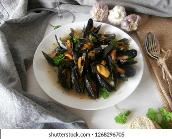 Mussels in wine. Mussels in white wine in butter with parsley.