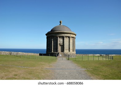 Mussenden Temple is located at a cliff overlooking Downhill Strand in the beautiful surroundings of Downhill Demesne near Castlerock in County Londonderry, Northern Ireland, UK