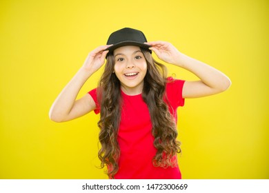 Must have street style accessory trends. Modern fashion. Kids fashion. Cute child wear cap or snapback hat. Little girl wearing baseball cap. Summer sun protection cap. Girl long curly hair wear cap.