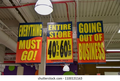"""""""Everything must go!"""" """"Entire store 40% to 60% off"""" and """"going out of business"""" signs advertising discounts at a store going out of business"""