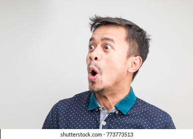 Mustache asian man look to right side feel facial shock and surprise on white background