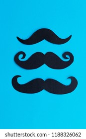 Mustache patterns on the blue background. November concept. Prostate Cancer and men's health awareness.