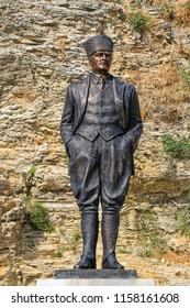 Mustafa Kemal Ataturk's sculpture in front of the historical Egirdir castle. August 2018 Egirdir-Isparta, Turkey
