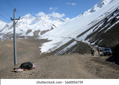 Mustang, Nepal - 21t March, 2015: People of Nepal. Sadhu (ascetic) sleeping the side of the road covered with an avalanche.