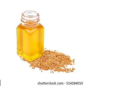 Mustard oil in bottle and seeds mustard