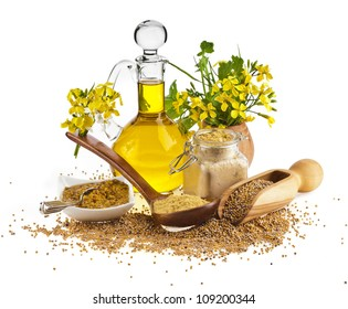 Mustard oil jar and mustard powder, seeds, spoon with mustard flower blossom on white
