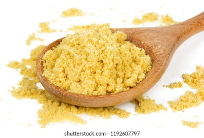 Mustard Powder in a Wooden Spoon Isolated on White Background