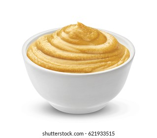 Mustard sauce in bowl isolated on white background. One of the collection of various sauces
