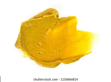 Mustard sauce. Splash of mustard on a white background.
