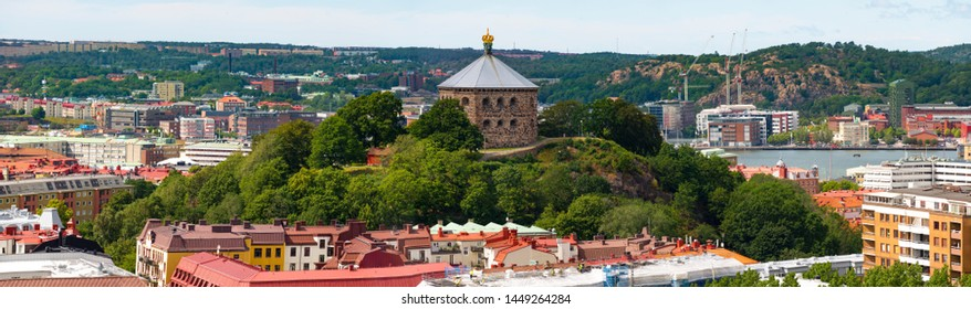"Must-See Place in Gothenburg while Traveling in Sweden is ""Skansen Krona"". Old fortress built on a hill in the central parts of the trendy city. Cityscape background."