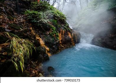 A must-visit natural footbath at the Oyunuma River, which is a hot spring river that flows from Lake Oyunuma, near Jigokudani hell valley, Noboribetsu, Hokkaido, Japan. Visitor can heel foot here.