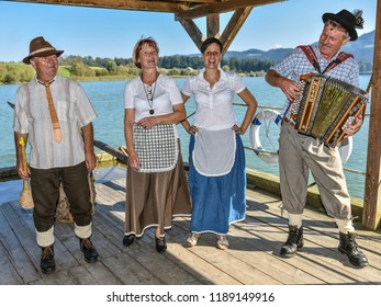 MUTA, SLOVENIA - SEPTEMBER 21th 2018: The musicians playing on the raft floating on Drava river entertaining tourists on a summer afternoon