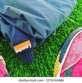 Mutah, al karak, Jordan - January 15, 2019 : Conceptual picture of Superdry Brand Winter Jacket and futsal Shoes