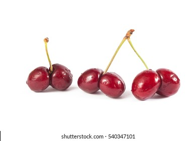 Mutated cherries on white background