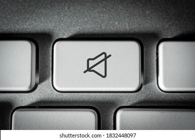 Mute key on a neat white keyboard