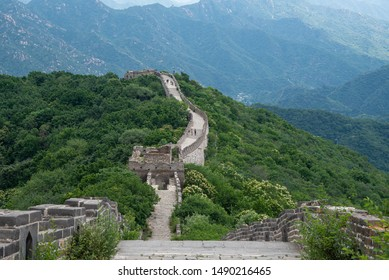 Mutianyu, Beijing, China -  June 7 2018: Tourist people walking at the famous Great Wall of China, one of the seven wonders of the world at Mutianyu Section outside Beijing in China