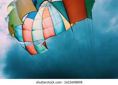 muticolor parachute against the blue sky