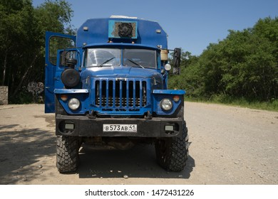 Mutnovsky, Kamchatka / Russia - July 26 2019: Front of Ural truck. Six wheel off road all terrain vehicle of Russian origin. Transportation of military as well as civilians in harsh road conditions