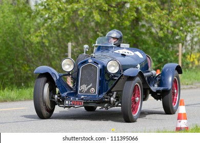 MUTSCHELLEN, SWITZERLAND-APRIL 29: Vintage pre war race car Alfa Romeo Grand Sport from  1931 at Grand Prix in Mutschellen, SUI on April 29, 2012.  Invited were vintage sports cars and motorbikes.