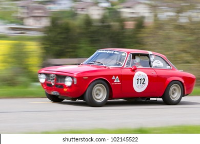 MUTSCHELLEN, SWITZERLAND-APRIL 29: Vintage race touring car Alfa Romeo Giulia Sprint GT from  1965 at Grand Prix in Mutschellen, SUI on April 29, 2012.  Invited were vintage sports cars, motorbikes.
