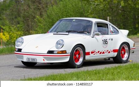MUTSCHELLEN, SWITZERLAND-APRIL 29: Vintage race touring car Porsche Carrera RS 2.7 from 1973 at Grand Prix in Mutschellen, SUI on April 29, 2012.  Invited were vintage sports cars and motorbikes.