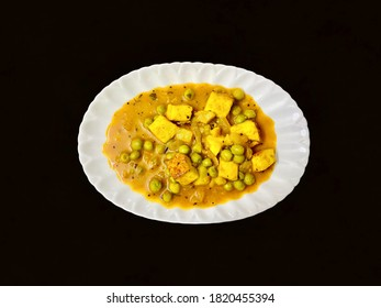 Mutter Panneer or green peas cheese cottage curry served in a plate