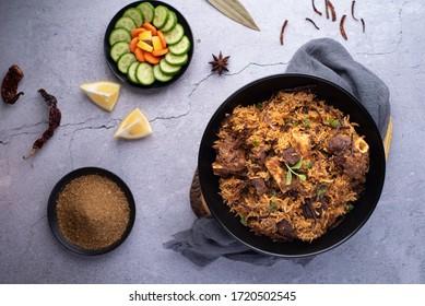Mutton Biriyani on a black dish - Shutterstock ID 1720502545
