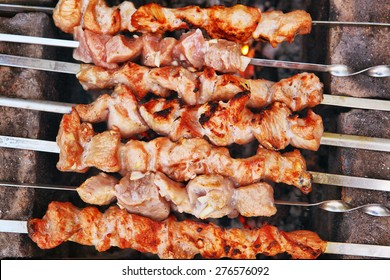 mutton meat made as a shashlik on the outdoor country pick-nick