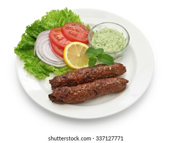 mutton seekh kabab with mint chutney isolated on white background