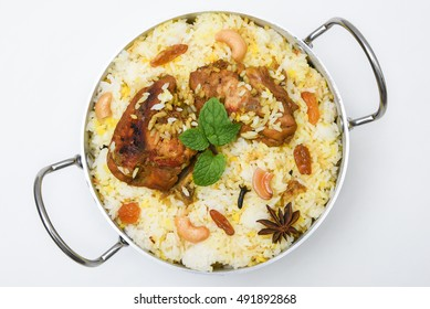 Mutton/lamb Gosht Biryani from India served in authentic copper utensils with mint leaf. Top view of Indian biriyani made of Long grain Basmathi Rice