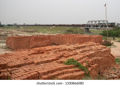 Muzaffarpur, India - February 28, 2019: Bricks stacked together at the location of brick kiln. Brick kiln manufactures the bricks and destroys the fertility of the land over the period.
