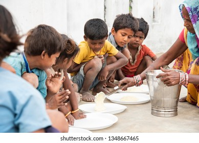 Muzaffarpur, India -  March 15, 2019: Poor young kids having their meal.