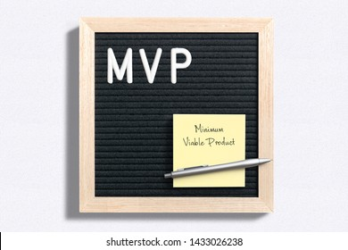 MVP written on letter board next to sticky note with Minimum Viable Product written on it over plain white surface
