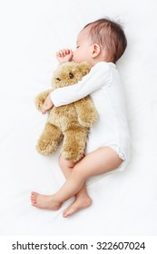 My Best Friend baby sleeping with her teddy bear, New family and baby protection concept